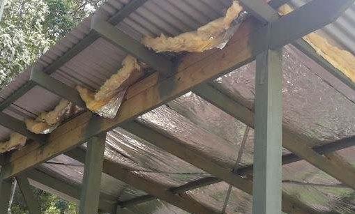 Insulating metal roofing fiberglass